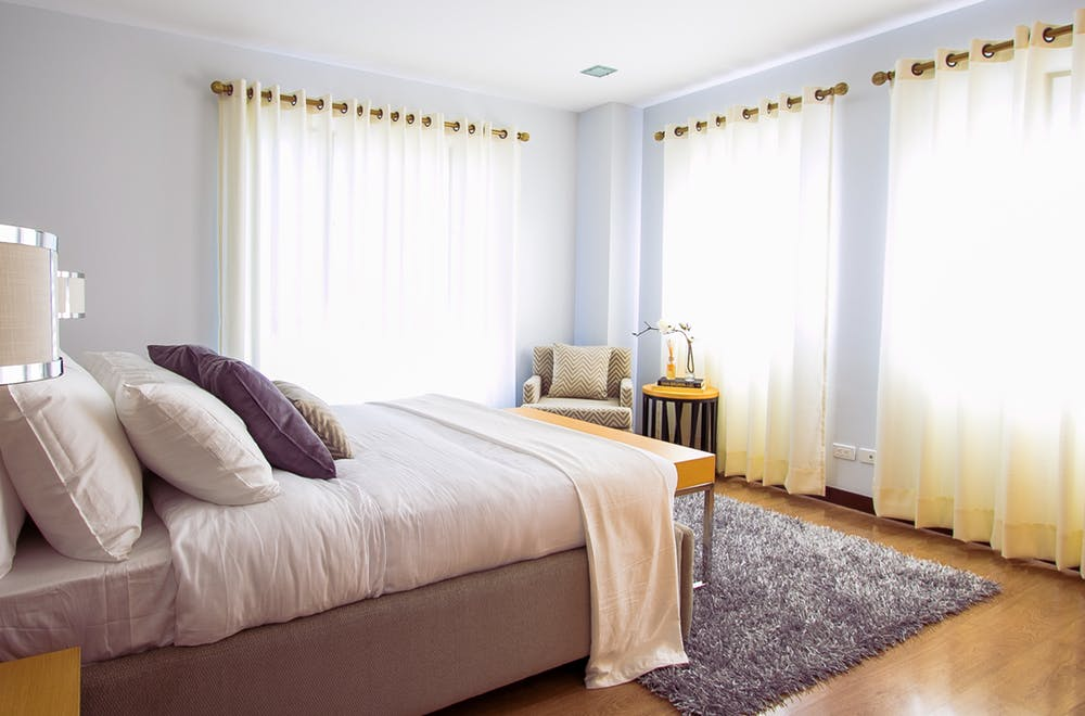 Bedroom with curtains and blinds in Sydney