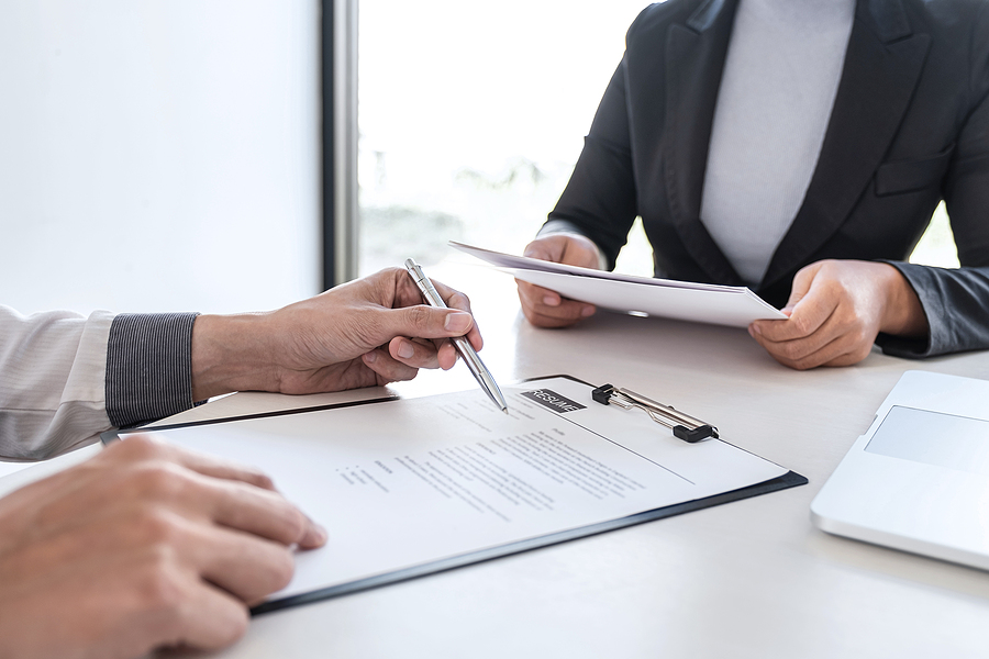 Recruiter holding a resume of an applicant