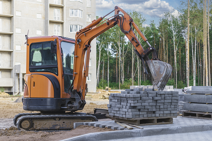 Mini excavator hire on construction site