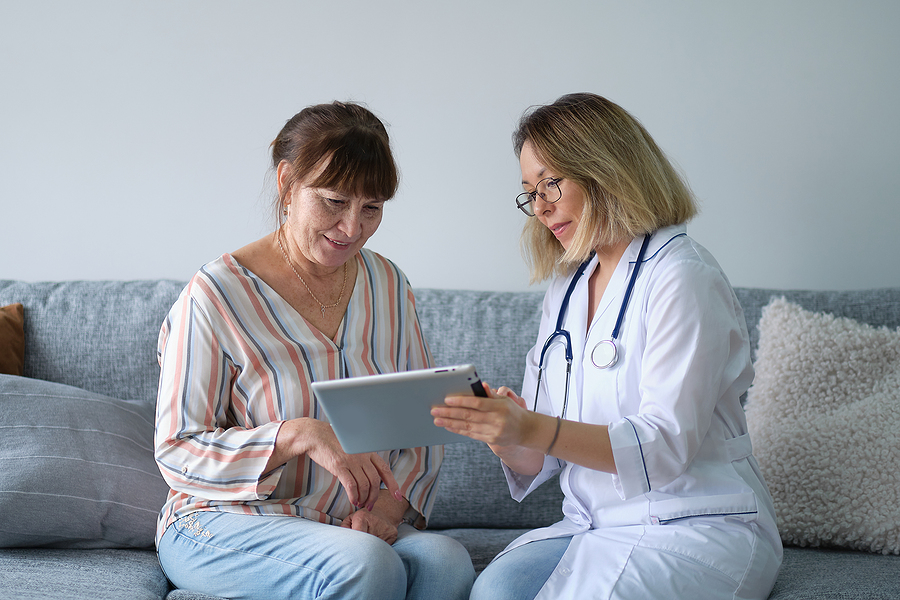 Gold Coast after hours doctor showing medical test results to her patient